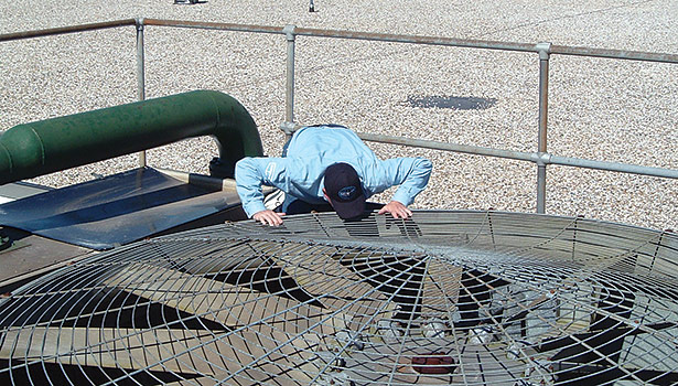 man visually inspecting Evapco cooling tower fan