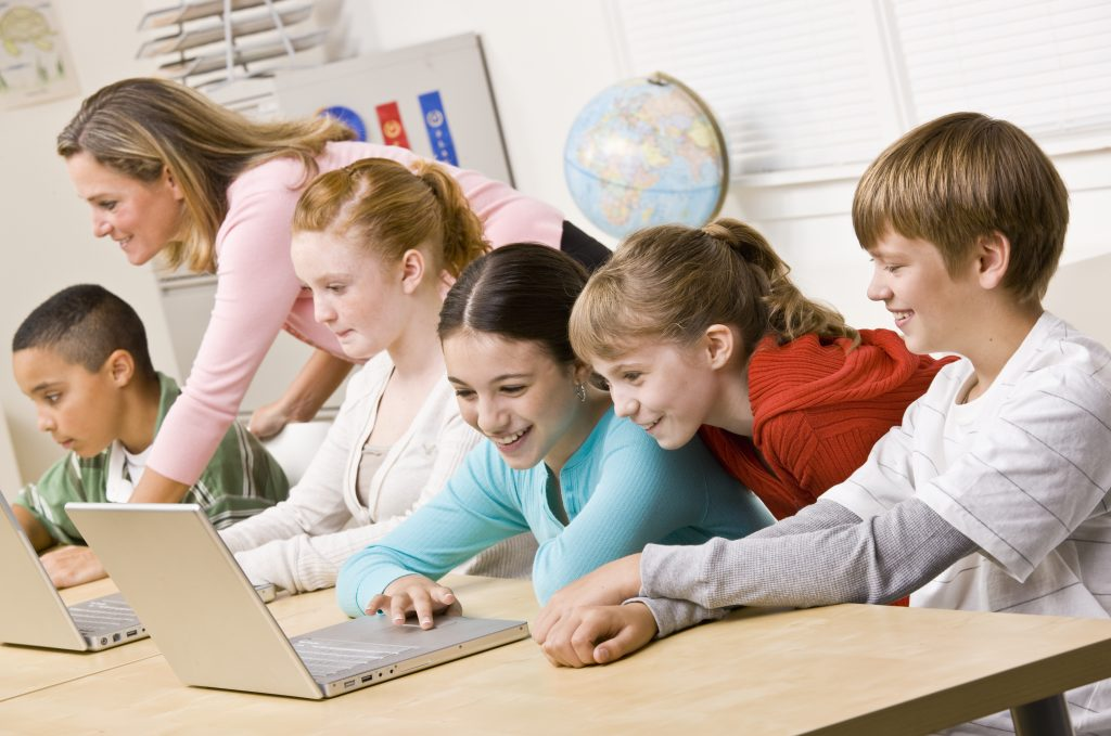 kids in classroom in school playing on computer