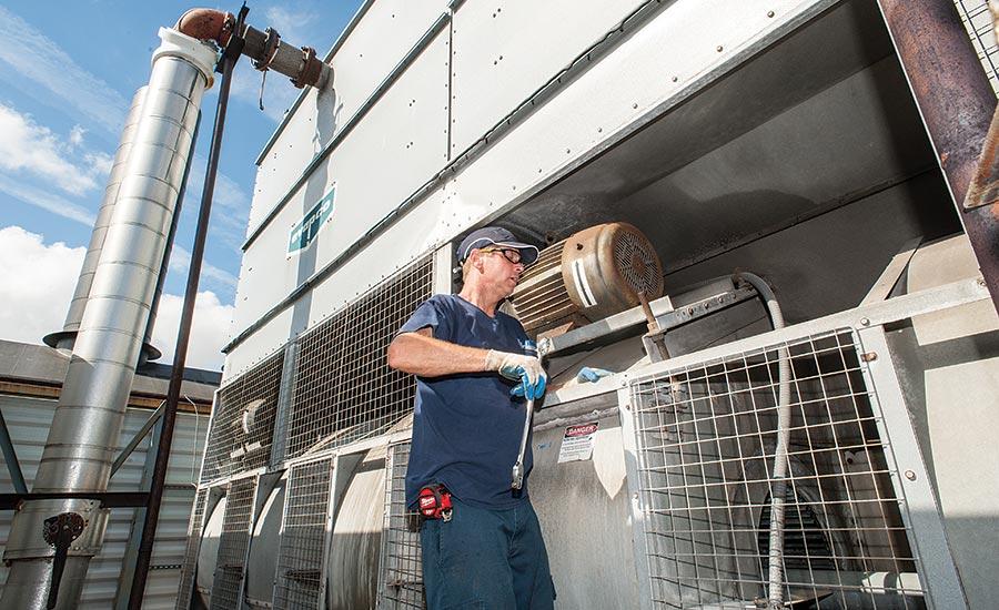 man working on cooling tower repair